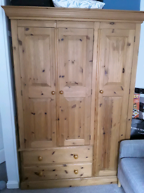 A lovely antique pine wardrobe with drawers