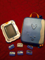 BLUE VTECH INOTAB, CASE AND 6 GAMES