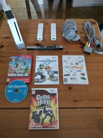 Nintendo wii bundle 2 controllers 5 games, av adapter, sensor ect..