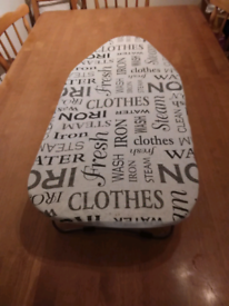 A tabletop ironing board