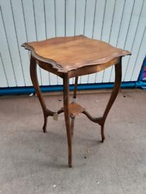 Antique mahogany window table