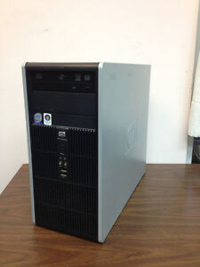 HP Compaq with two monitors, keboard and mouse