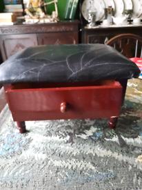 small black footstool