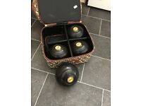 Set of 4 used bowling bowls with carry case