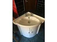 White plastic corner sink with unit