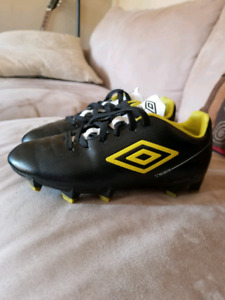 Updated! Umbro cleats size 1 AND Mitre shin guards