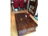 Solid coffee table with ample storage