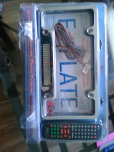 Electric scrolling license plate frame