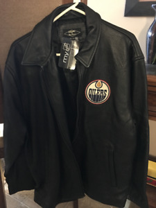 LEATHER JACKET (Never worn) With OILERS CREST (Price reduced)