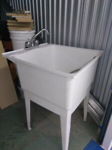 Laundry sink with faucet