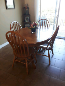 Oak dining room table and china cabinet