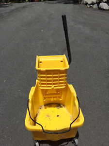 rolling mop bucket with wringer and mop.