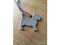 Radley branded metal dog tag for bag