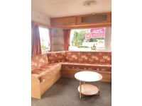 Caravan with promotional site fee offer at Wemyss Bay Holiday Park