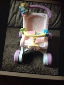 Baby walker / toy pushchair fisher price