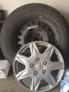 Set of 4 goodyear nordic winter tires with 4 wheel covers
