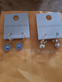 Two pairs of OLIVER BONAS earings