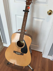 Yamaha F310 Guitar, case, stand, capo and music books