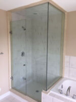 CUSTOM FRAMELESS GLASS SHOWERS, WIRE-SHELVE, SLIDERS AND MIRRORS