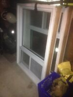 Two (2) Vinyl windows with wood framing