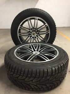 2 winter tires on rims (studded)