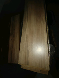 100 sqft laminate with underpad. Brand new in box