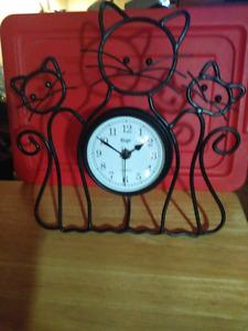 Free standing wrought iron cat clock