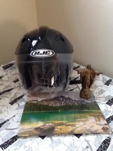 Mans Motorcycle Helmets (three)