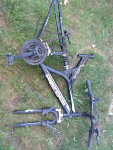 Two Vice mountain bike frames with parts