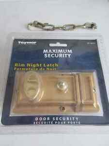 Taymor Rim Night Latch plus another security for inside of door.