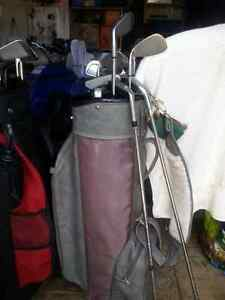 Two set of golf clubs