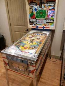 Spin wheel pinball machine