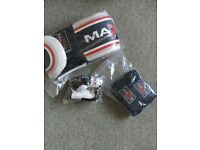 Unopened Boxing gloves and wraps (plus rear view mirror gloves!)