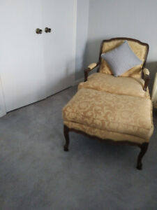 A LOVELY BERGERE CHAIR AND OTTOMAN