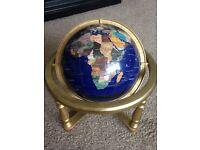 Globe set with semi precious stone.