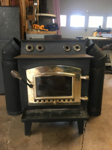 Air tight wood stove with accessories 650.00 OBO