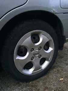 Nissan 4 bolt steel rims with winters