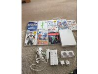 Nintendo wii with 2 controllers, 8 games and a wii fit board