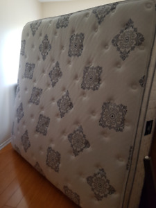 King size mattress with boxes and frame.