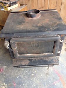 pot belly wood burning stove with double insulated pipe