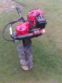 Petrol post hole borer