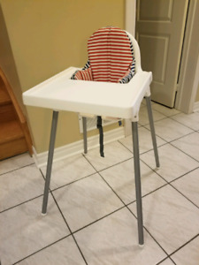Highchair with safety belt and back rest