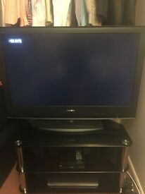 "Sony Bravia 42"" TV and black glass stand"