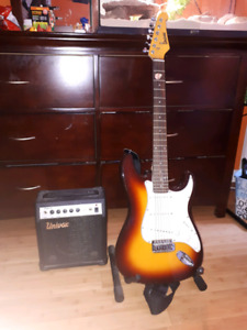 Guitar with amp and stand