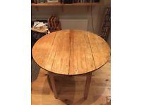 Extendable round farmhouse kitchen table
