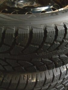 Four 215/70R15 tires with rims for GM