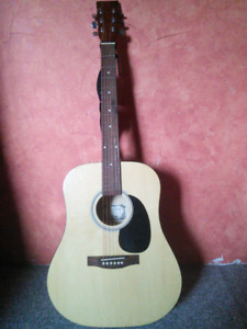 Acoustic Guitar with Spare Strings and Case