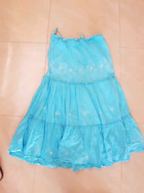 Blue gypsy skirt size 12 will fit a 10 to 14 it's got a tie string