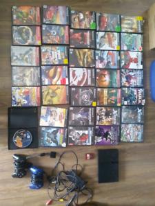PS2 avec 34 jeux 2 manettes et une carte memoire