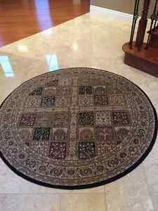 5' round black carpet with brown and burgundy